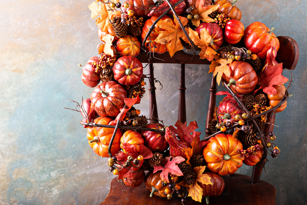 orange and yellow fall wreath displayed on a chair