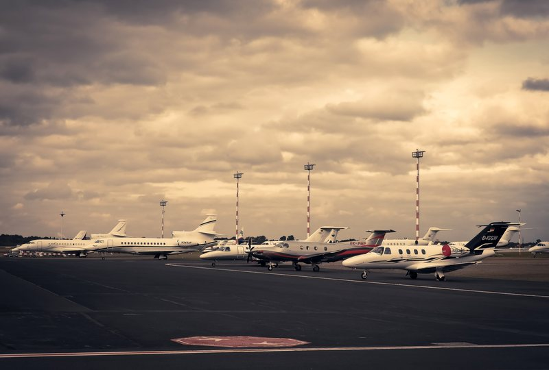 Planes lined up on a runway