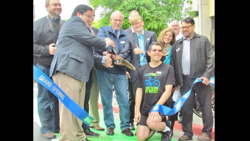 Jesse and Council cutting a ribbon on Fulton Street.jpg