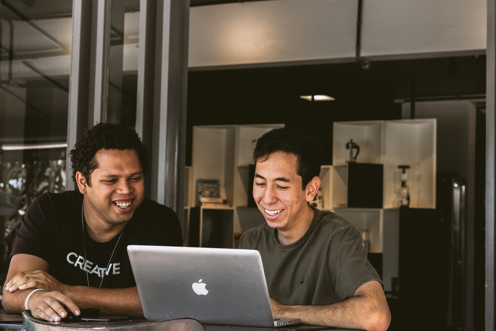 People smiling using a computer.