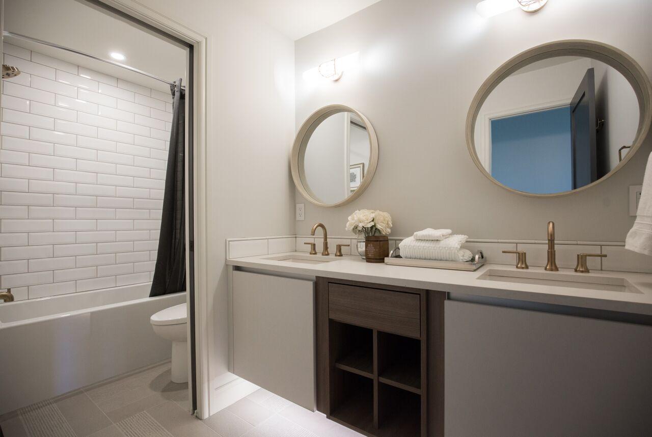Calgary interior design modern traditional cosy elegant bathroom subway tile circle mirrors under cabinet lights