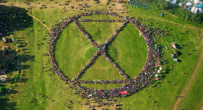 A view from the air of people forming a giant Extinction Symbol at Glastonbury festival 2019.