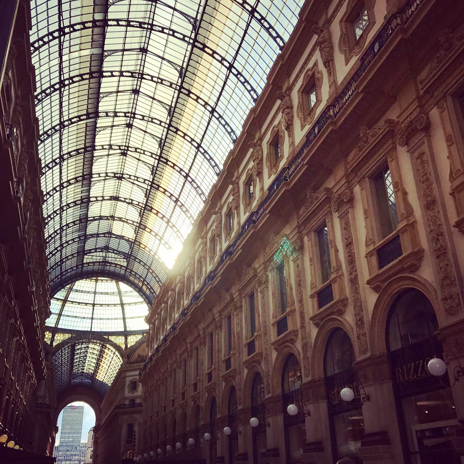 milan Galleria Vittorio Emanuele II, famous tourist site at piazza duomo. Grand architecture and glass ceiling hosts luxury boutiques and is one of the highlights of milano. see it on an Italy road trip