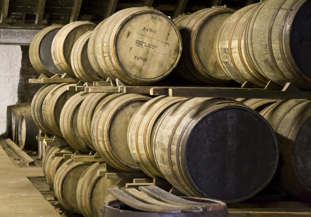 A racked warehouse of maturing oak casks.