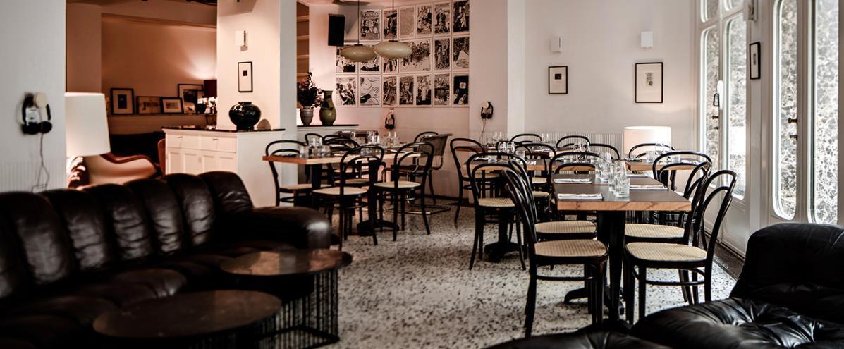 Restaurant de l'hôtel avec ses tables et ses chaises