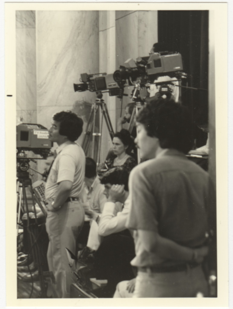 Members of the press filming the hearings.