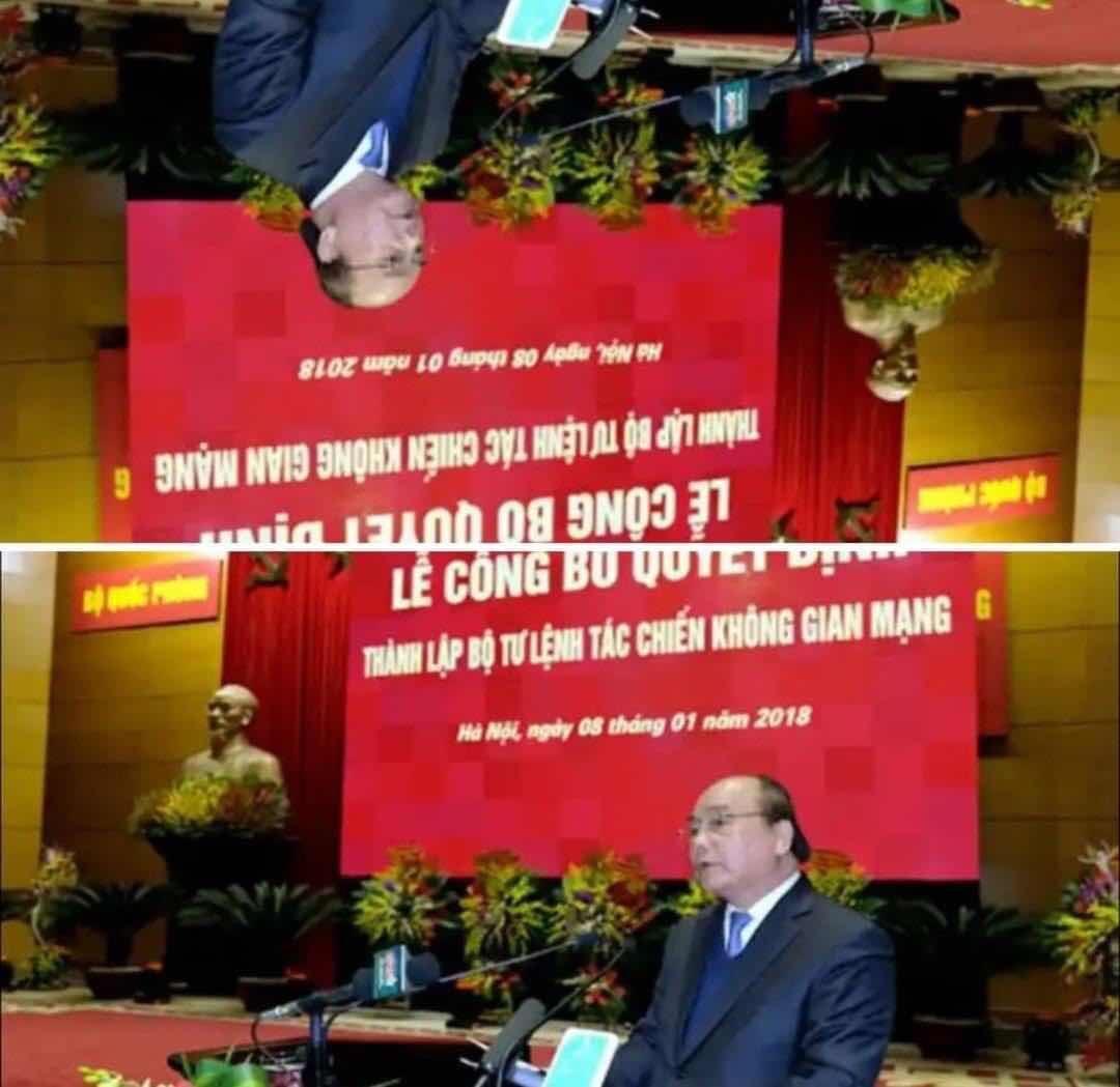 Ảnh: Thủ tướng Nguyễn Xuân Phúc phát biểu trong lễ công bố thành lập Cục tác chiến không gian mạng trực thuộc Bộ Quốc phòng Việt nam, ngày 8/1/2018, dưới cái nhìn 2 chiều.