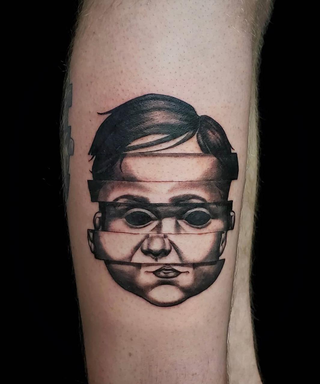 realistic child portrait tattoo