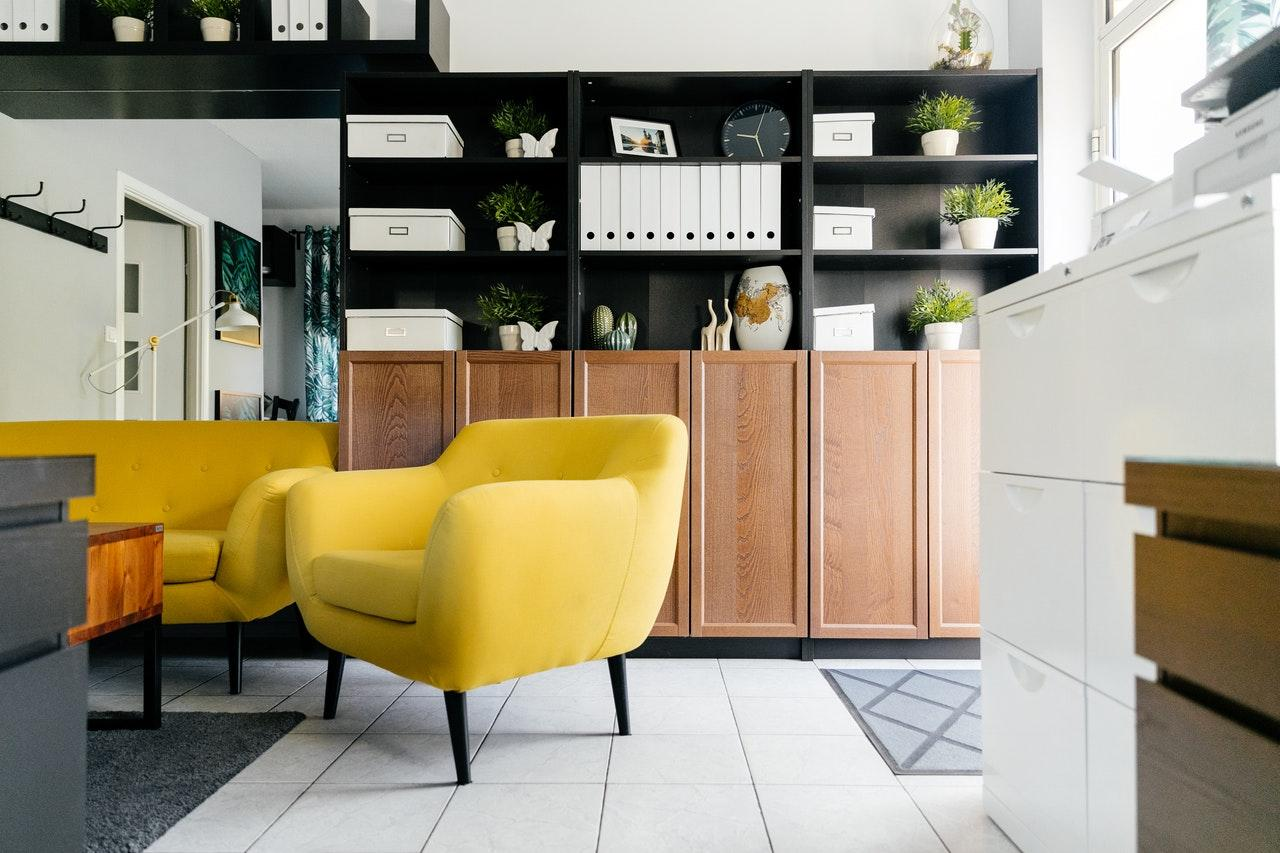 A yellow chair in a room  Description automatically generated with medium confidence