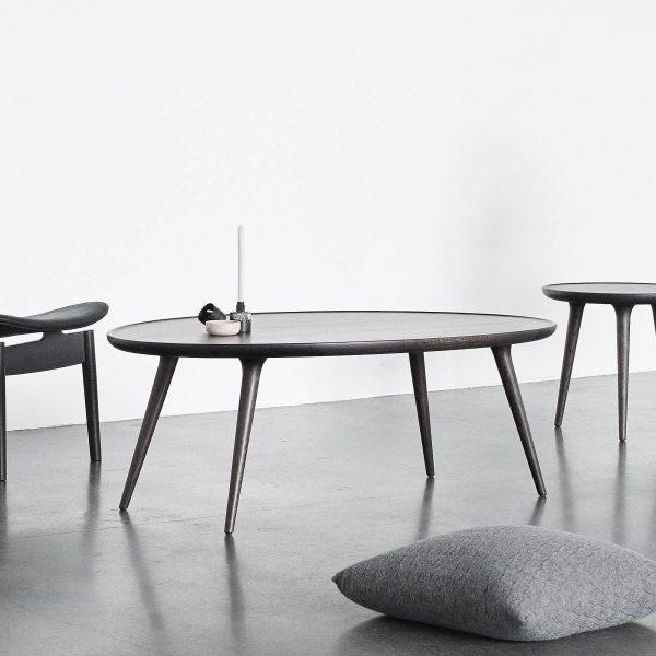 http://cdn.home-designing.com/wp-content/uploads/2021/04/dark-wood-oval-coffee-table-sculpted-tapered-legs-raised-lip-unique-scandinavian-furniture-for-minimalist-living-room-decor-600x600.jpg