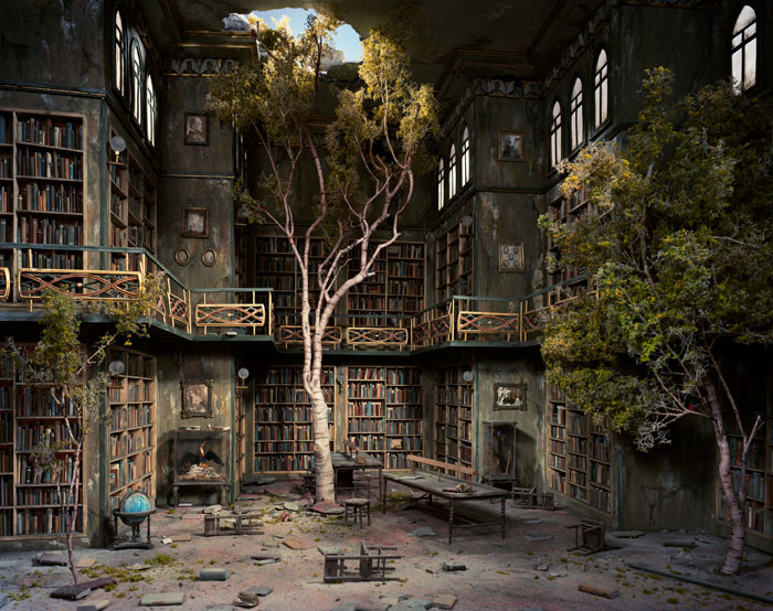A picture of a post-apocalyptic library, with books still on shelves but trees growing through the floor