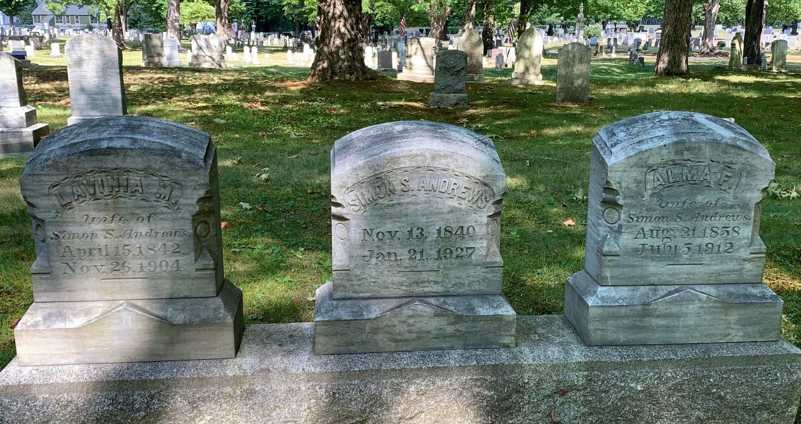 Three connected headstones for Simon Andrews (died 1927) and his first wife, Lavinia (died 1904) and second wife, Alma . (died 1912).