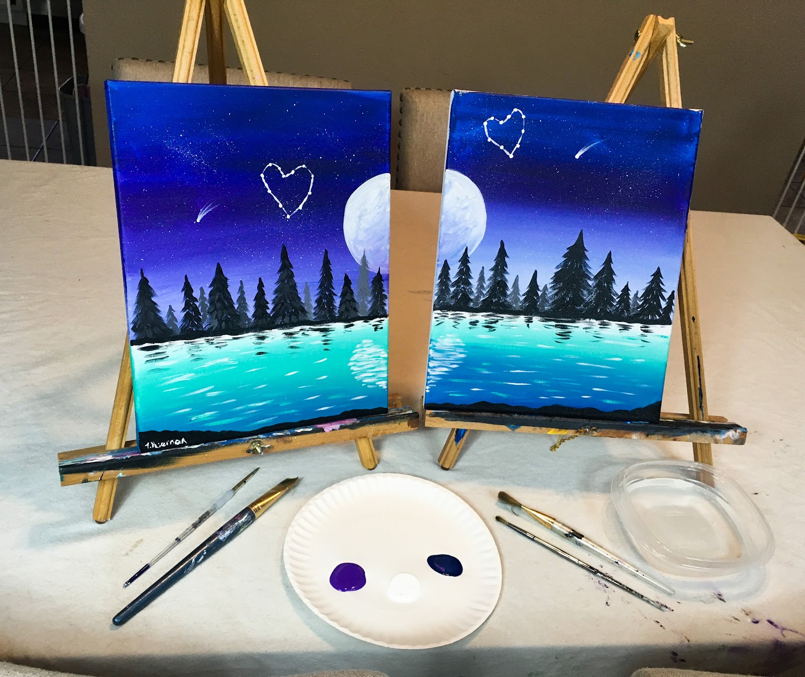 set up for couples date night at home paint night with painted canvases