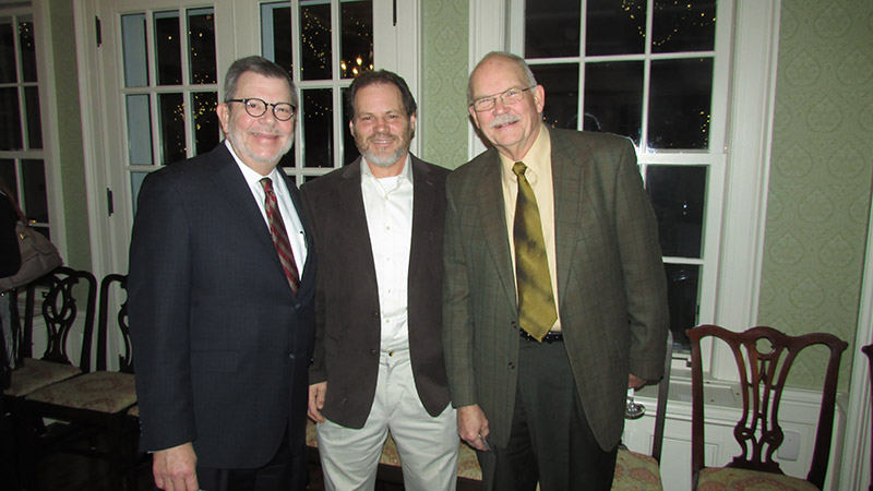Eric Kaler, Jim Chamberlin and Bob Backman standing together at 20th anniversary event