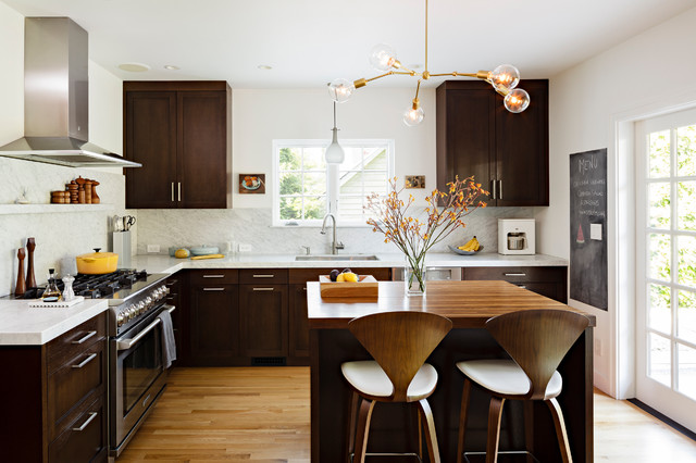 contemporary brown kitchen with bright white painted walls, wood flooring and silver cabinet hardware
