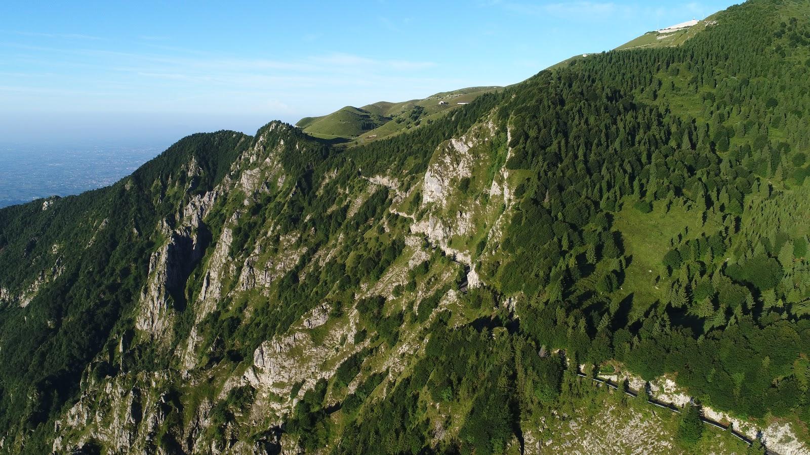 Biking Monte Grappa - Cavaso del Tomba - Aerial Drone photo of tunnel, road, cliff