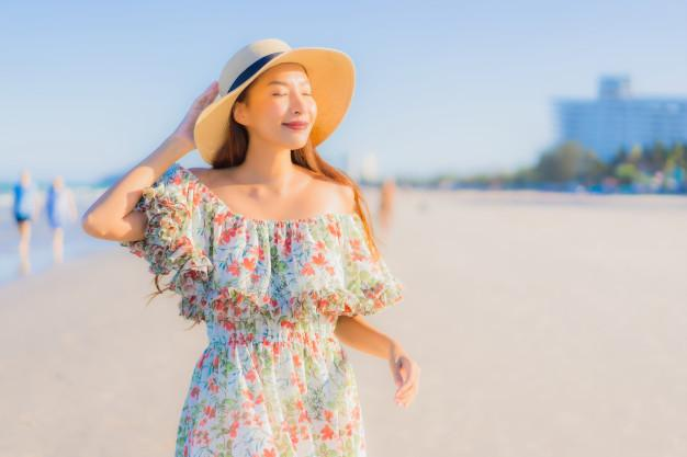 Portrait beautiful young asian woman happy smile relax around tropical beach sea ocean Free Photo