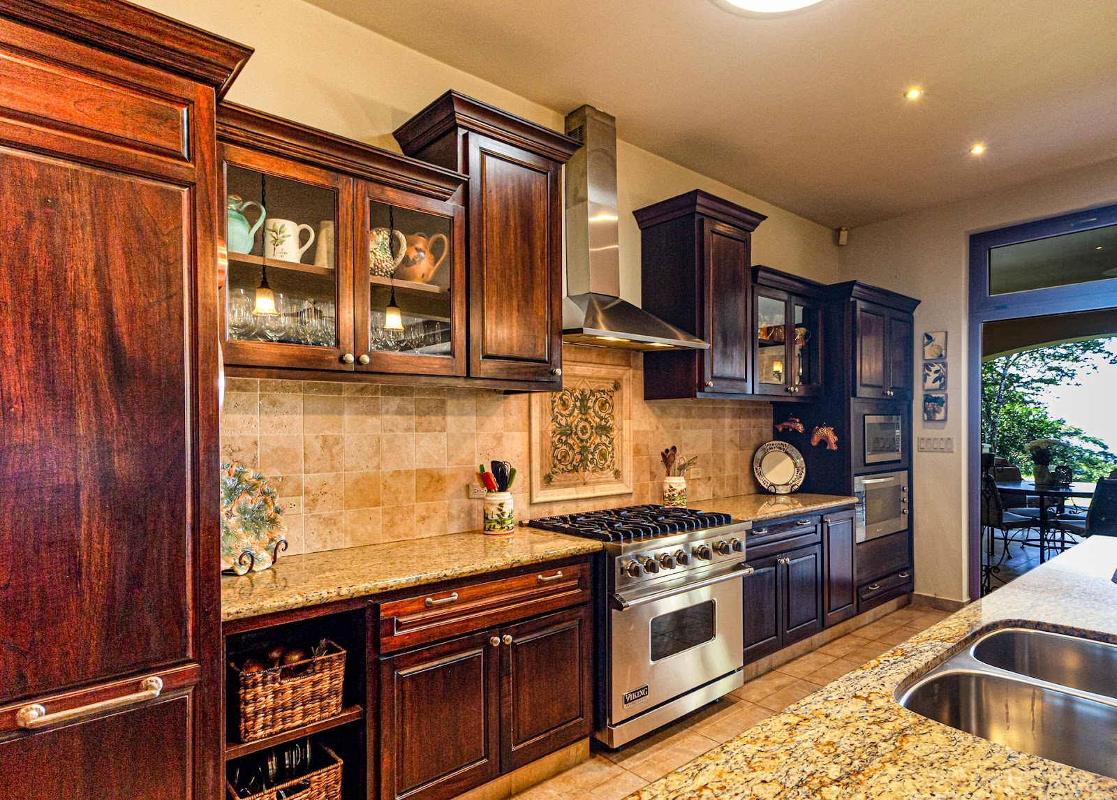 A rustic cabinet design for your kitchen creates a warm and inviting aesthetic; wooden cabinets with marble countertops