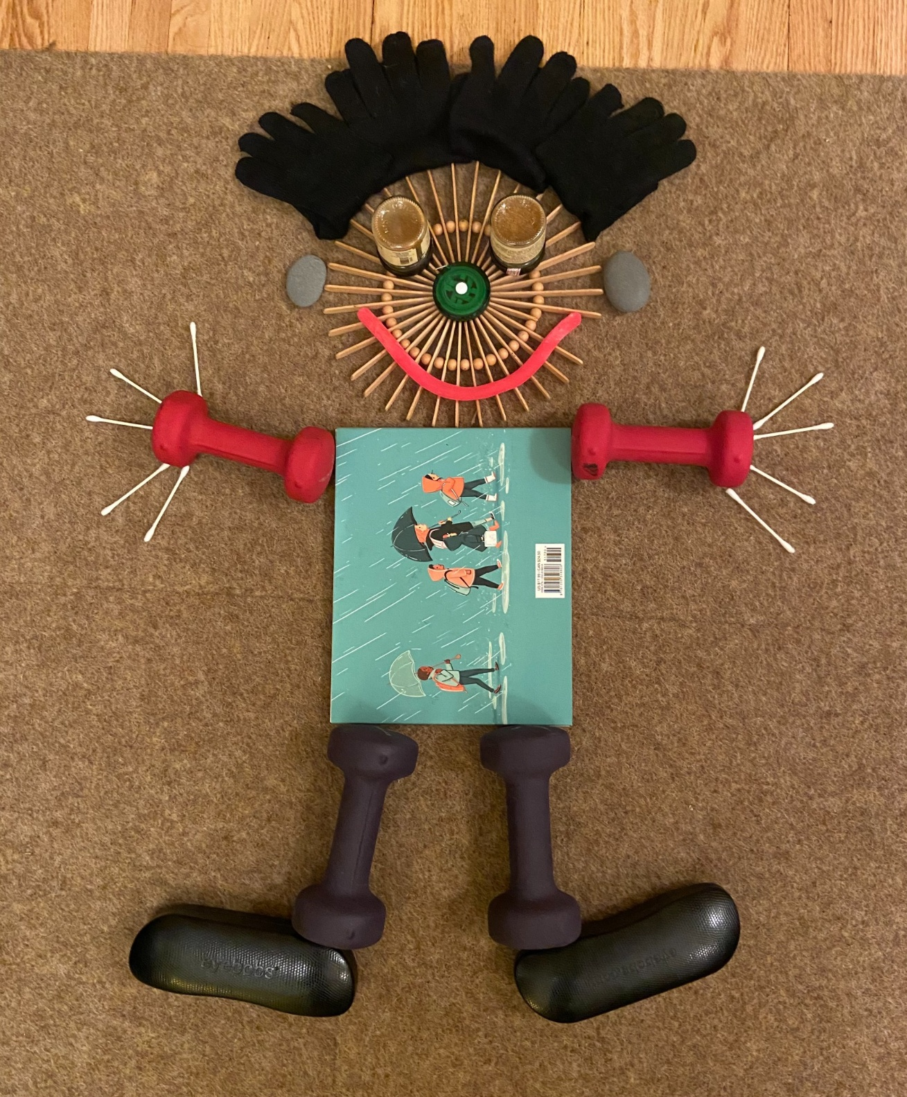 person built out of household items