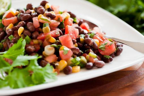 https://media.istockphoto.com/photos/black-bean-salad-on-white-plate-siting-horizontally-on-table-picture-id155158510?b=1&k=6&m=155158510&s=170667a&w=0&h=-Z4DeZU34uhMSjFMpbfcLxIXlRVc0sVhFtTrT-I_KHQ=