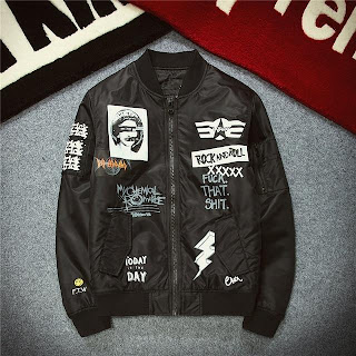 Black bomber jacket with many designs including photo of Marilyn Monroe, My Chemical Romance Logo, Text saying 'Rock and Roll', 'Fuck that shit', Lightning design