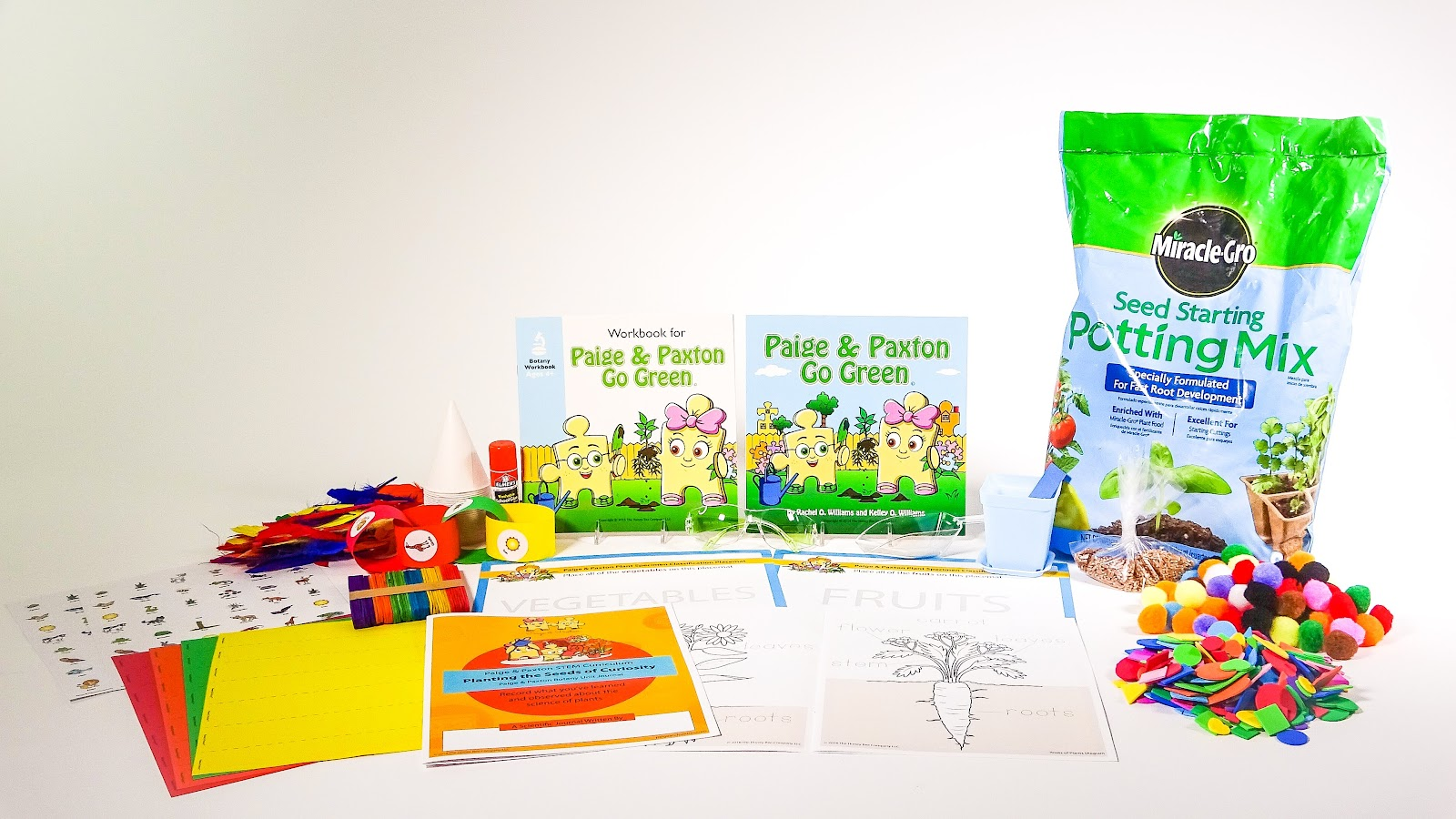 This shows all of the items included in this Botany-focused STEM kit for elementary students, including fertilized potting soil, STEM stories, diorama materials and labeled diagrams of plant parts.