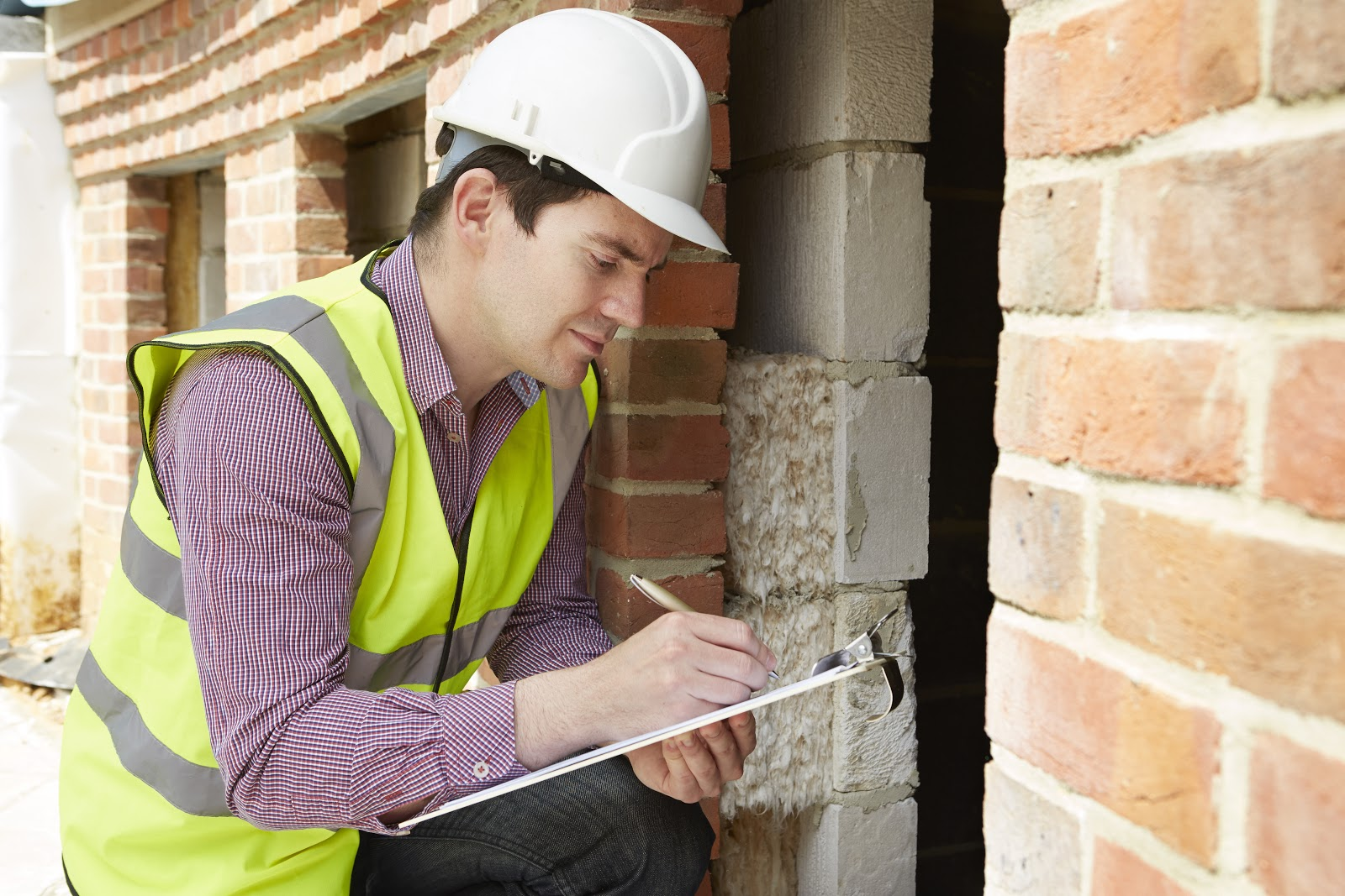 structural engineer performing foundation inspection