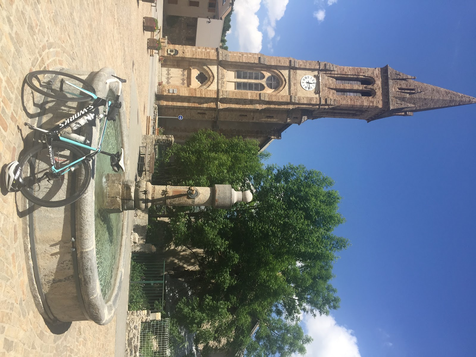 Cycling Col du Galibier from Villar-D'Arene - bike at fountain in square at Villar-D'Arene