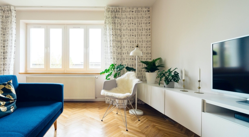 hanging your drapes high with furniture that sits low can make your small apartment seem more spacious