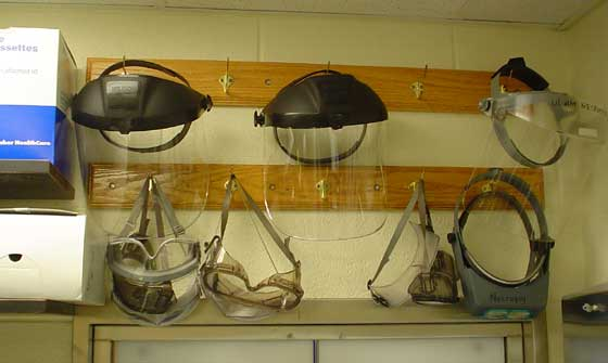 Face shields, safety goggles and optical loupes provided to personnel within the animal necropsy area. (Photo credit: R. Ilkhani-Pour and D. Molnar).