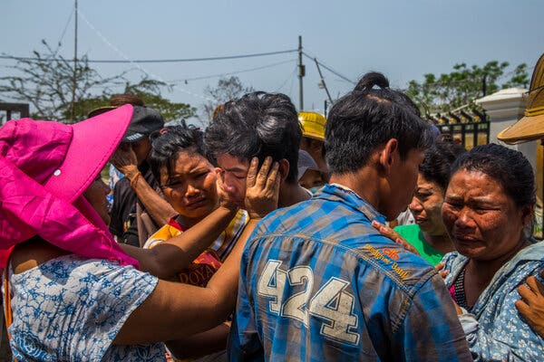 Family mourning the death of a protesters who was shot in the chest by security forces on Saturday in Dala, near Yangon.