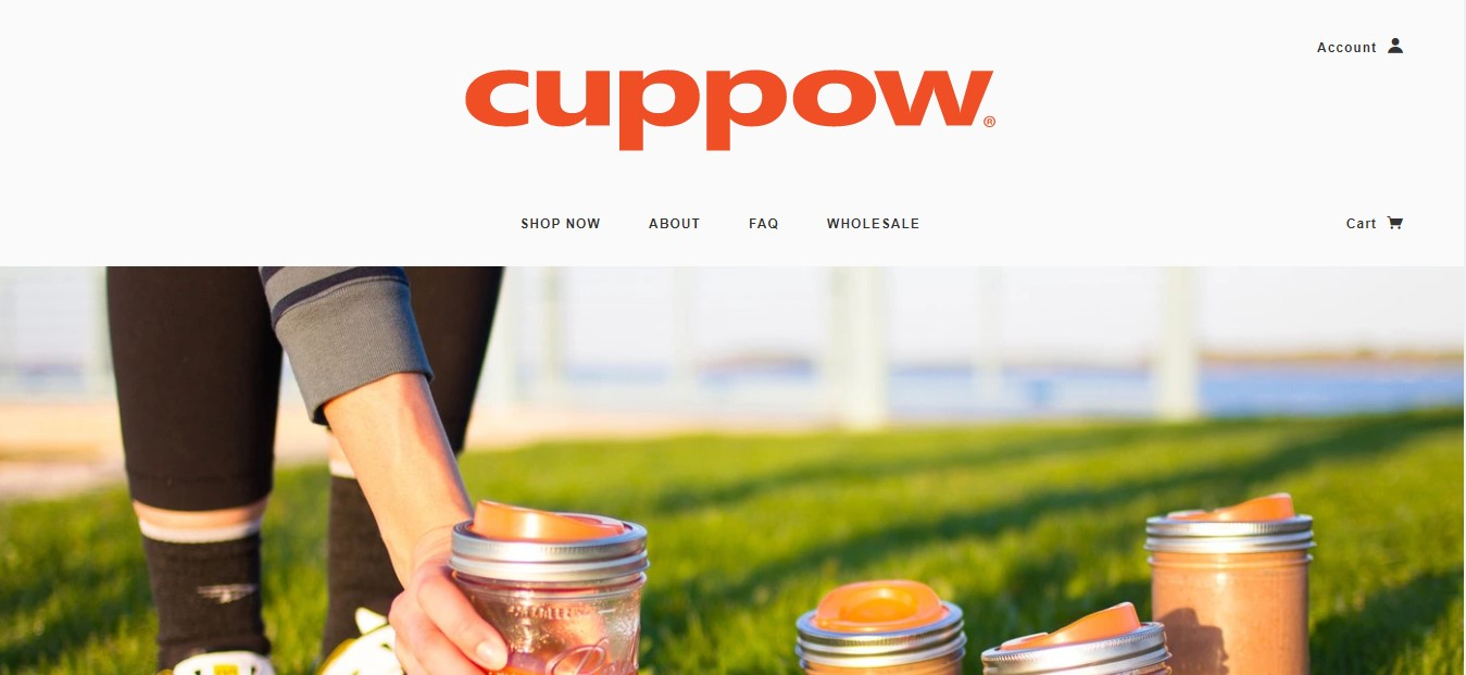 Cuppow's landing page - food containers in grass