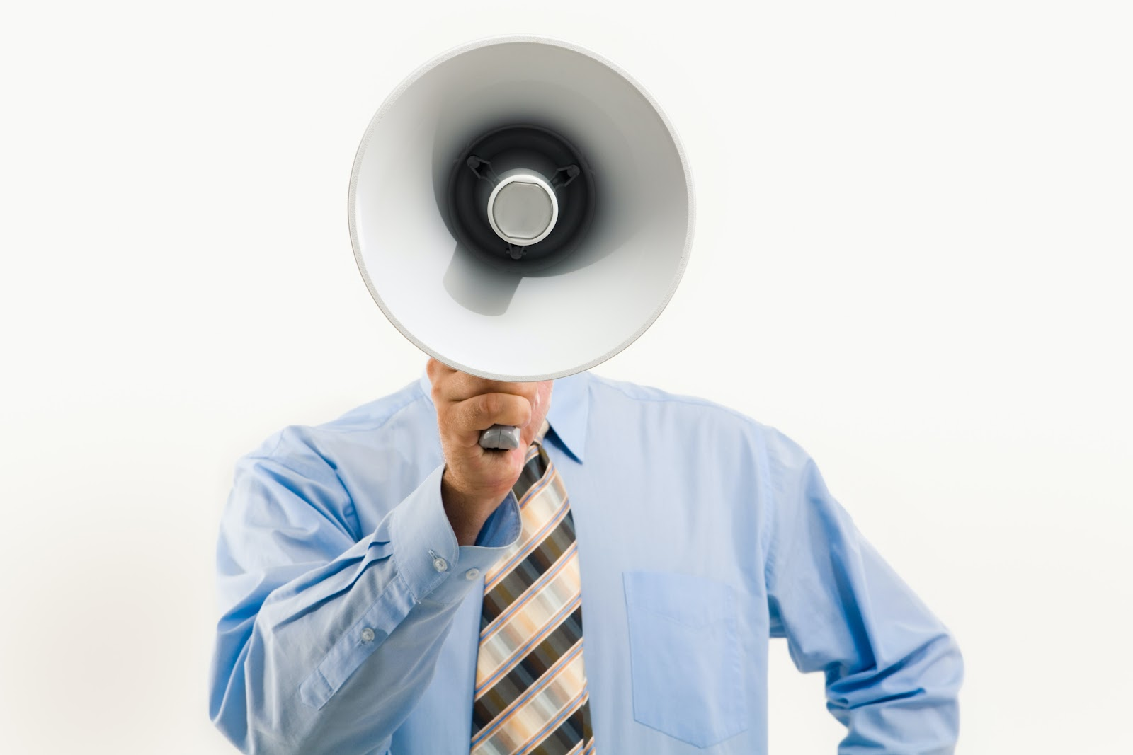 A business person holding a megaphone that obscures their face.