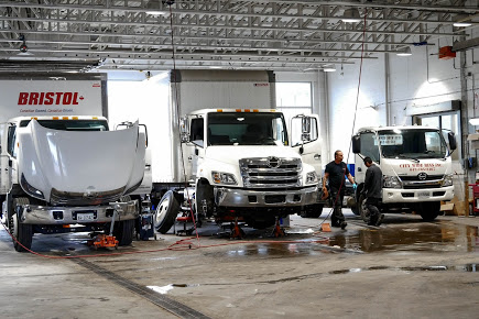 Hino delivery trucks being serviced inside Somerville Hino's North York garage