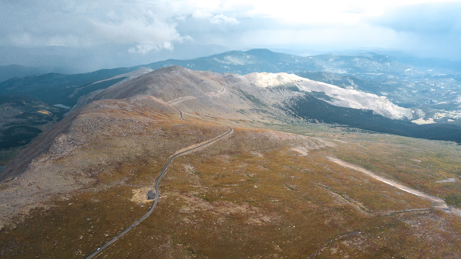 Bike climb Mt. Evans - aerial drone photo just before Summit Lake - roadway and mountains