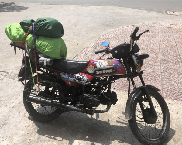 An old motorbike with luggage: Buying a Motorcycle in Vietnam
