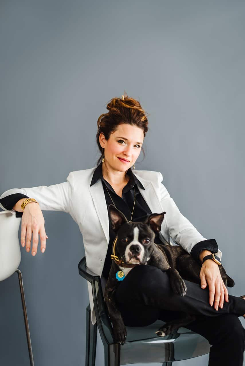 Lap of Love founder Dr. Dani McVety with white coat and dog on her lap