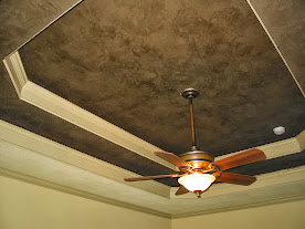 Decorative finish on tray ceiling.
