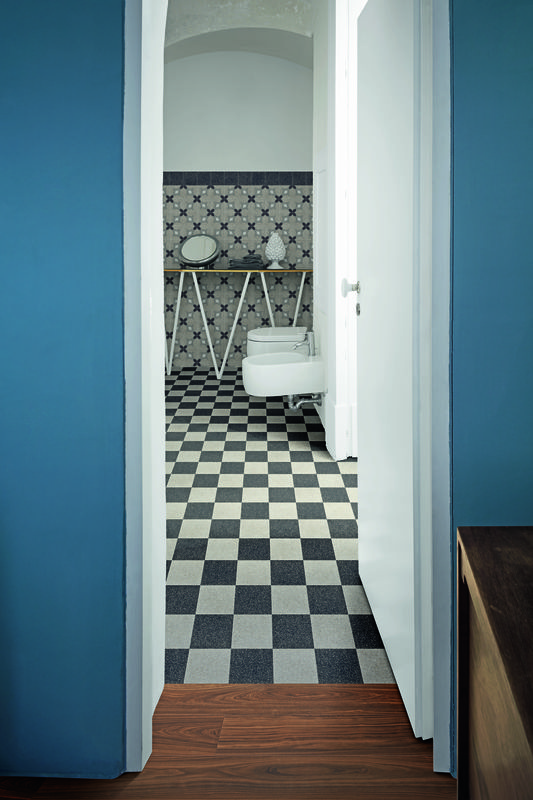 Bathroom with black and white checkerboard tile flooring