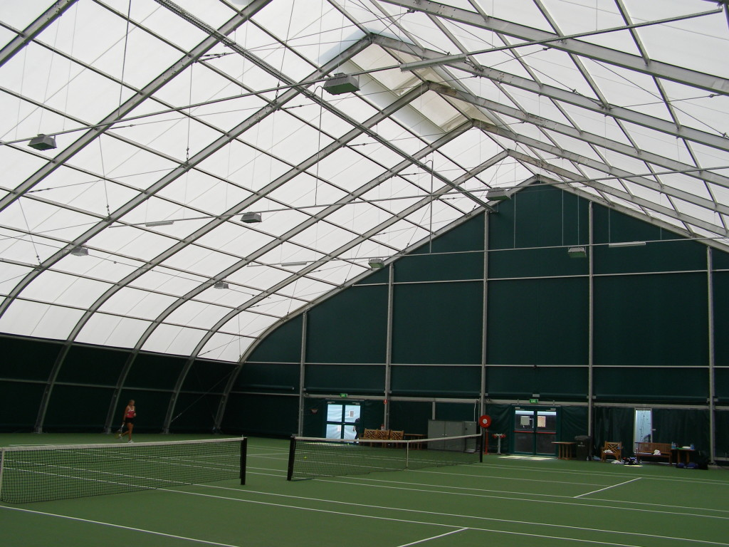tension fabric sports structure interior with bright opaque energy efficient fabric ceiling and doors laid out with indoor tennis courts.