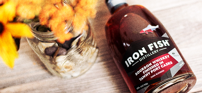 Bottle of Bourbon Whiskey Finished In Tawny Port Casks by Iron Fish Distillery