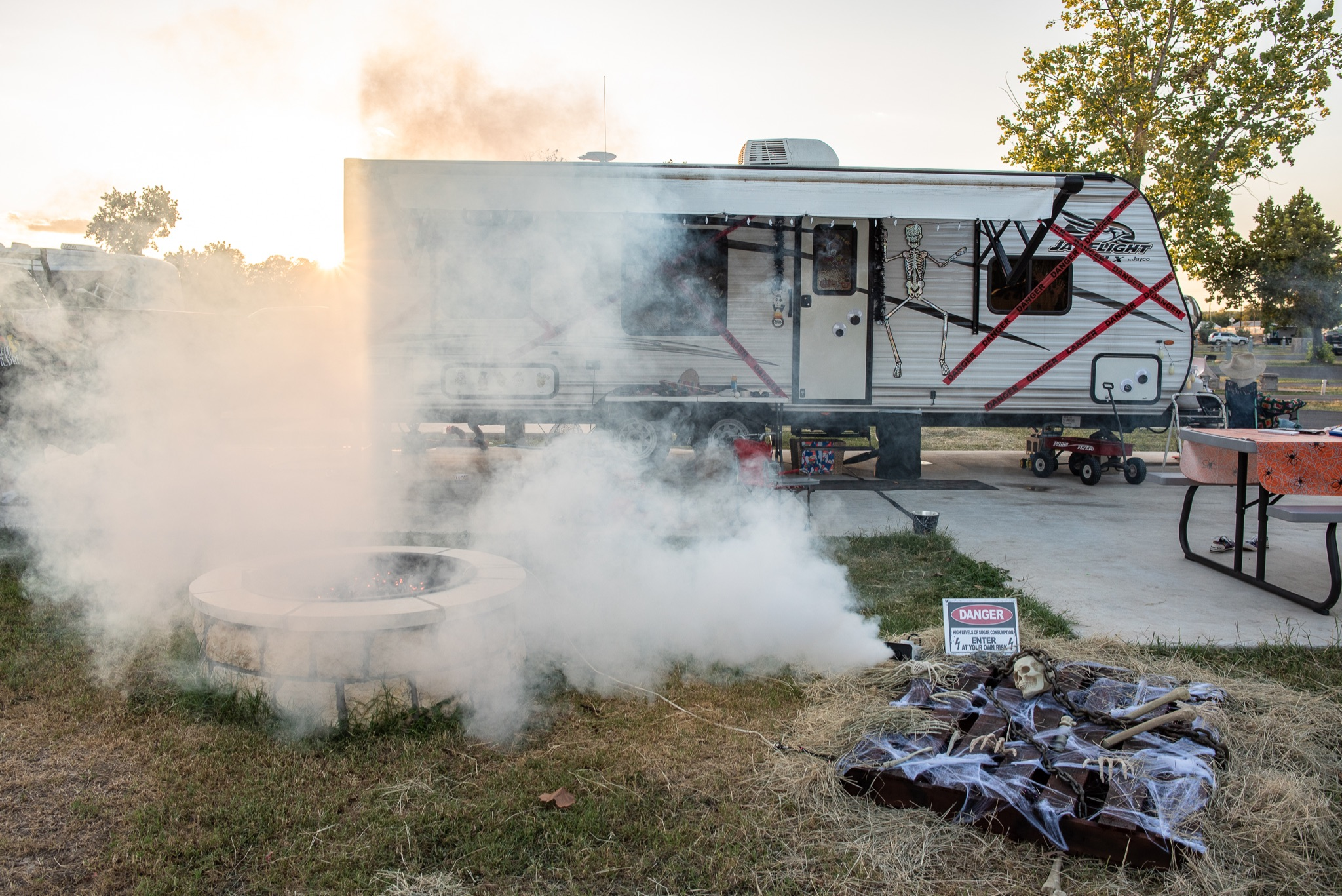 RV and campsite decorated for halloween with smoke machine