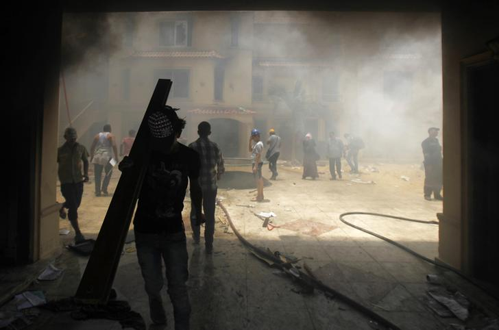 meet 34338 7341d Muslim Brotherhood HQ overrun afterward weekend protests, U.S. accused of  spying on allies, and authority forces aggression Homs, Syria.