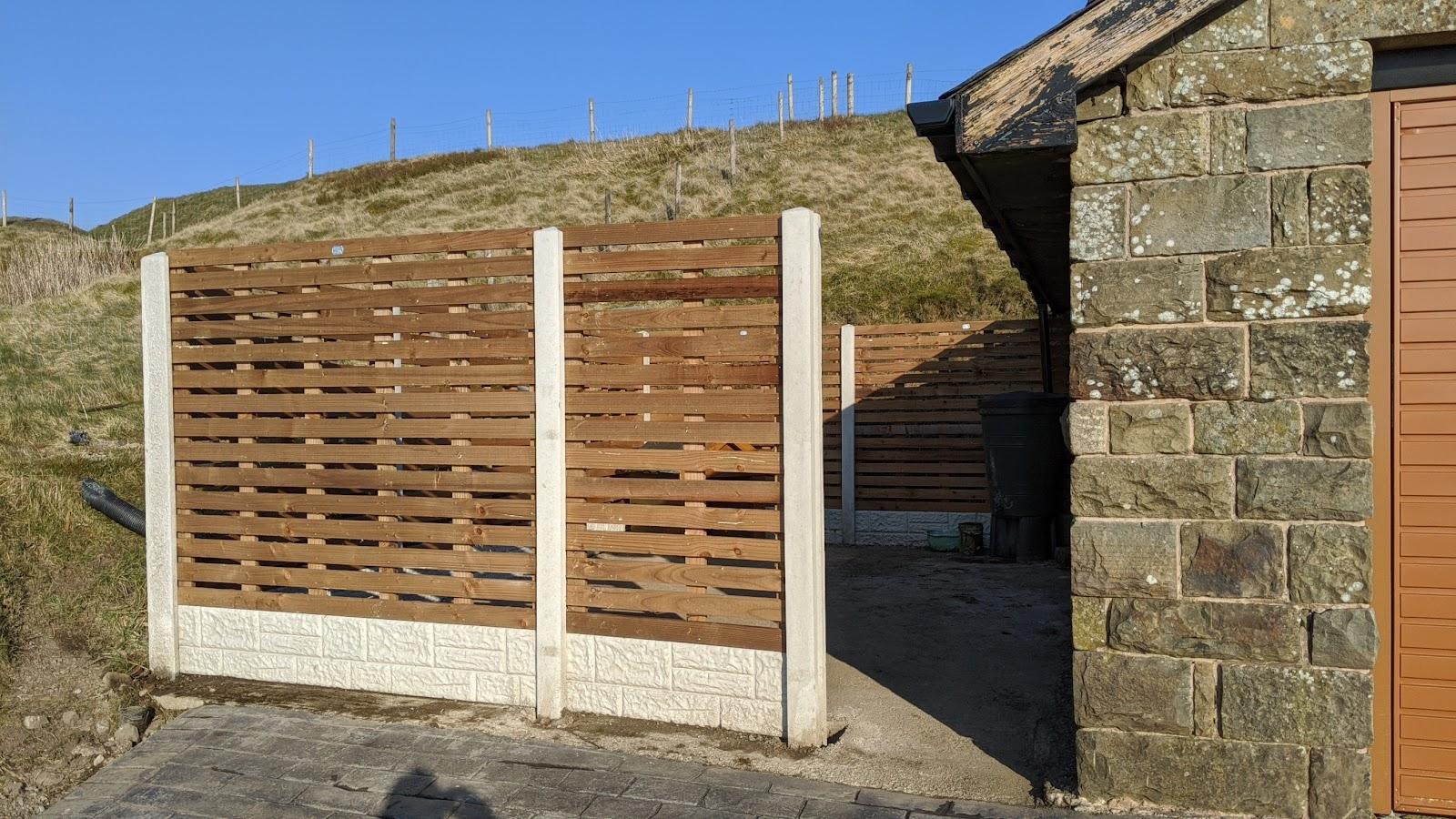 Custom made slatted fence panels