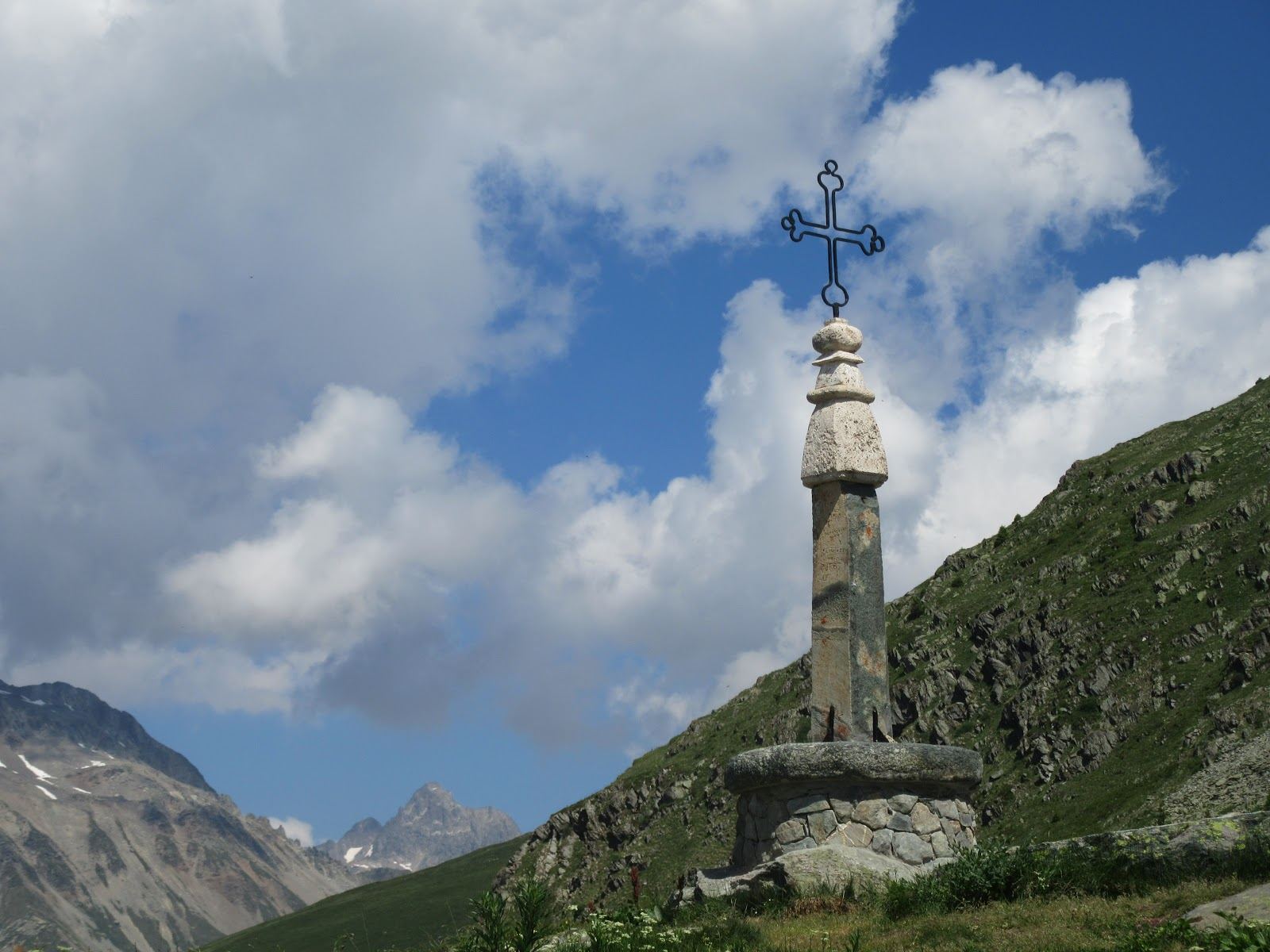 Cycling Col de la Croix de Fer, Saint-Jean-de-Maurienne - the iron cross, sky and mountain